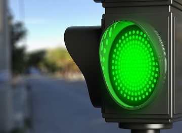 Green traffic lights on blur street background, copy space. 3d illustration